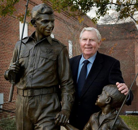 Andy Griffith standing next to Andy and Opie Statue at Andy Griffith Museum